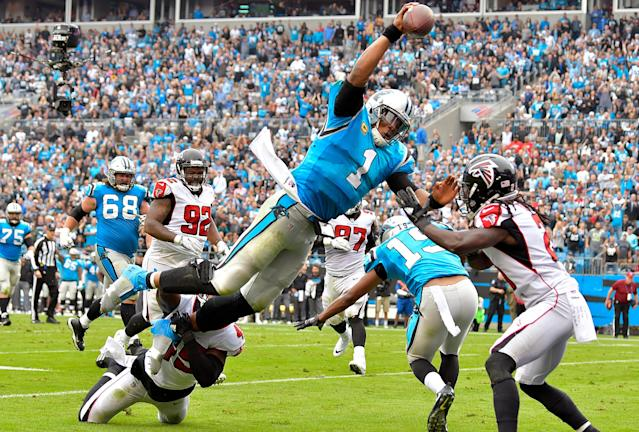 <p>Cam Newton #1 of the Carolina Panthers dives into the end zone for a touchdown during the second quarter of their game against the Atlanta Falcons at Bank of America Stadium on November 5, 2017 in Charlotte, North Carolina. (Photo by Grant Halverson/Getty Images) </p>