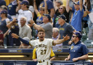 Milwaukee Brewers' Willy Adames reacts to Rowdy Tellez' three-RBI pinch hit home run against the Pittsburgh Pirates during the seventh inning of a baseball game Wednesday, Aug. 4, 2021, in Milwaukee. (AP Photo/Jeffrey Phelps)