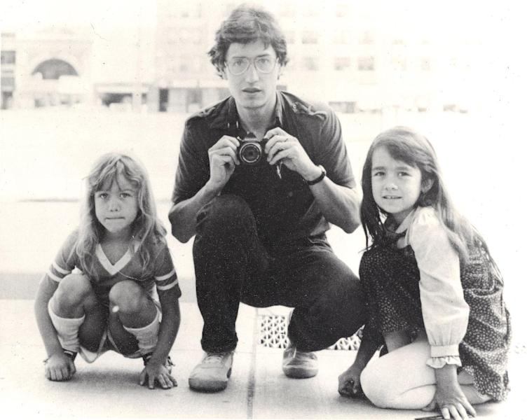 """In this undated photo provided by Keely Walker Muse, her father journalist John Clay Walker poses for a portrait with his daughters Lannie, left, and Keely in Minneapolis, Minnesota. Mexican drug lord Rafael Caro Quintero was sentenced to 40 years in prison for the 1985 murders of Walker, his friend Alberto Radelat, and DEA agent Enrique """"Kiki"""" Camarena, among other crimes. According to witnesses interviewed by DEA agents hunting for Camarena's killers, the cartel had mistaken Walker and Radelat for undercover agents. Caro Quintero walked free in August 2013, 12 years early after a local appeals court overturned his sentence for three of the murders. Walker was a Marine who was twice wounded by land mines in Vietnam and then worked as a newspaper journalist before taking his family to Mexico so he could write his book in a place where his pension could stretch further. He and his wife were befriended by Radelat, a dentist looking at taking classes at the main university in Guadalajara. (AP Photo/Courtesy Keely Walker-Muse)"""