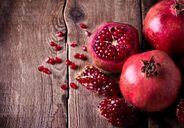 """<p>It's not always easy to eat a pomegranate, especially since they're so hard to peel, but pomegranate juice is easy to drink and will give you the same benefits. A <a href=""""https://www.ncbi.nlm.nih.gov/pubmed/22648092"""" rel=""""nofollow noopener"""" target=""""_blank"""" data-ylk=""""slk:September 2012 study"""" class=""""link rapid-noclick-resp"""">September 2012 study</a> in <em>Plant Foods for Human Nutrition </em>suggests that the high antioxidant levels in pomegranate juice can help lower blood pressure. </p><p><strong>Try it:</strong> When you're buying pomegranate juice, just make sure it has no sugar added. We like <a href=""""https://www.amazon.com/POM-Wonderful-Pomegranate-Juice-Bottles/dp/B00J0IG92Q?tag=syn-yahoo-20&ascsubtag=%5Bartid%7C10050.g.35715382%5Bsrc%7Cyahoo-us"""" rel=""""nofollow noopener"""" target=""""_blank"""" data-ylk=""""slk:POM Wonderful 100% Pomegranate Juice"""" class=""""link rapid-noclick-resp"""">POM Wonderful 100% Pomegranate Juice</a>.</p>"""