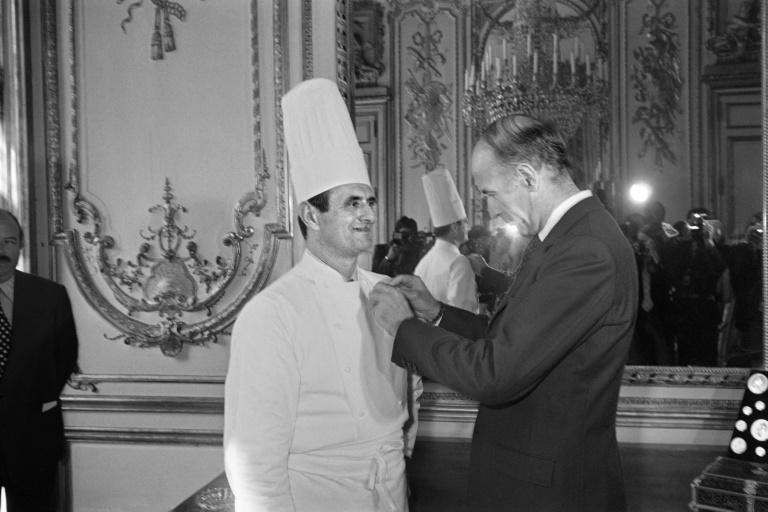 Top French chef Paul Bocuse is awarded the French Legion d'honneur by President Valery Giscard d'Estaing in 1975