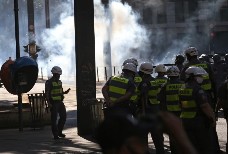 Police officers take position as they face demonstrators during a protest against Brazilian President Jair Bolsonaro in Sao Paulo
