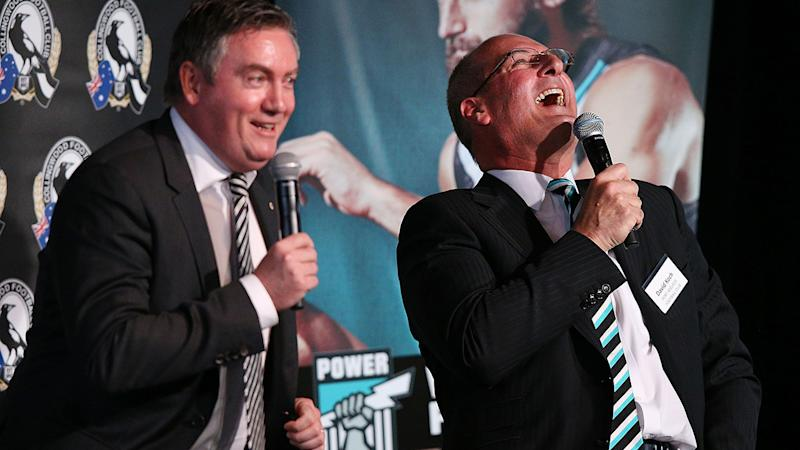 Eddie McGuire and David Koch, pictured here speaking at the MCG in 2014.