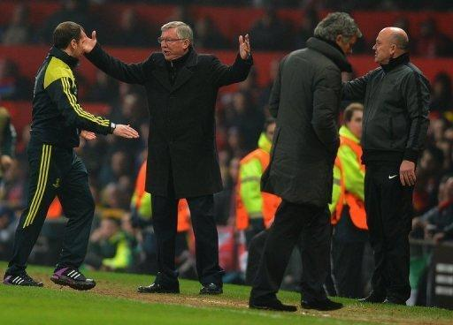 Manchester United manager Alex Ferguson berates the fourth official after seeing Nani sent off, on March 5, 2013. Real Madrid came from behind to win 2-1 at Old Trafford on Tuesday and complete a 3-2 aggregate win