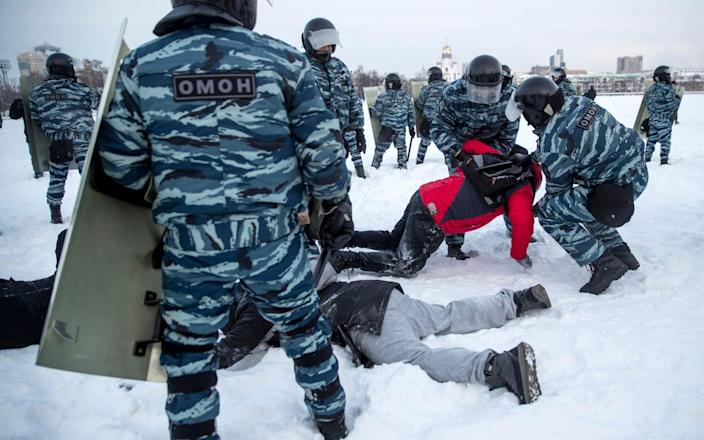 Police detain men during a protest against the jailing of opposition leader Alexei Navalny in Yekaterinburg