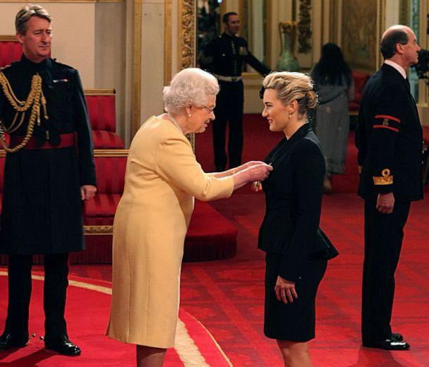 FILE PHOTO: Queen Elizabeth II awards British actress Kate Winslet a CBE (Commander of the Most Excellent Order of the British Empire) for services to drama, during an Investiture ceremony at Buckingham Palace in central London, U.K., Nov. 21, 2012. (Dominic Lipinski/AP)