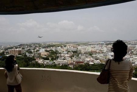 Visitors look out over U.S. Marine Corps Air Station Futenma in Ginowan on Okinawa May 3, 2010. REUTERS/Issei Kato/Files