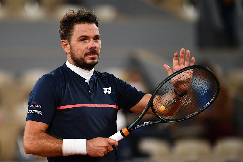 Stanislas Wawrinka celebrates after winning against Britain's Andy Murray during their first round match on Day 1 of The Roland Garros 2020.
