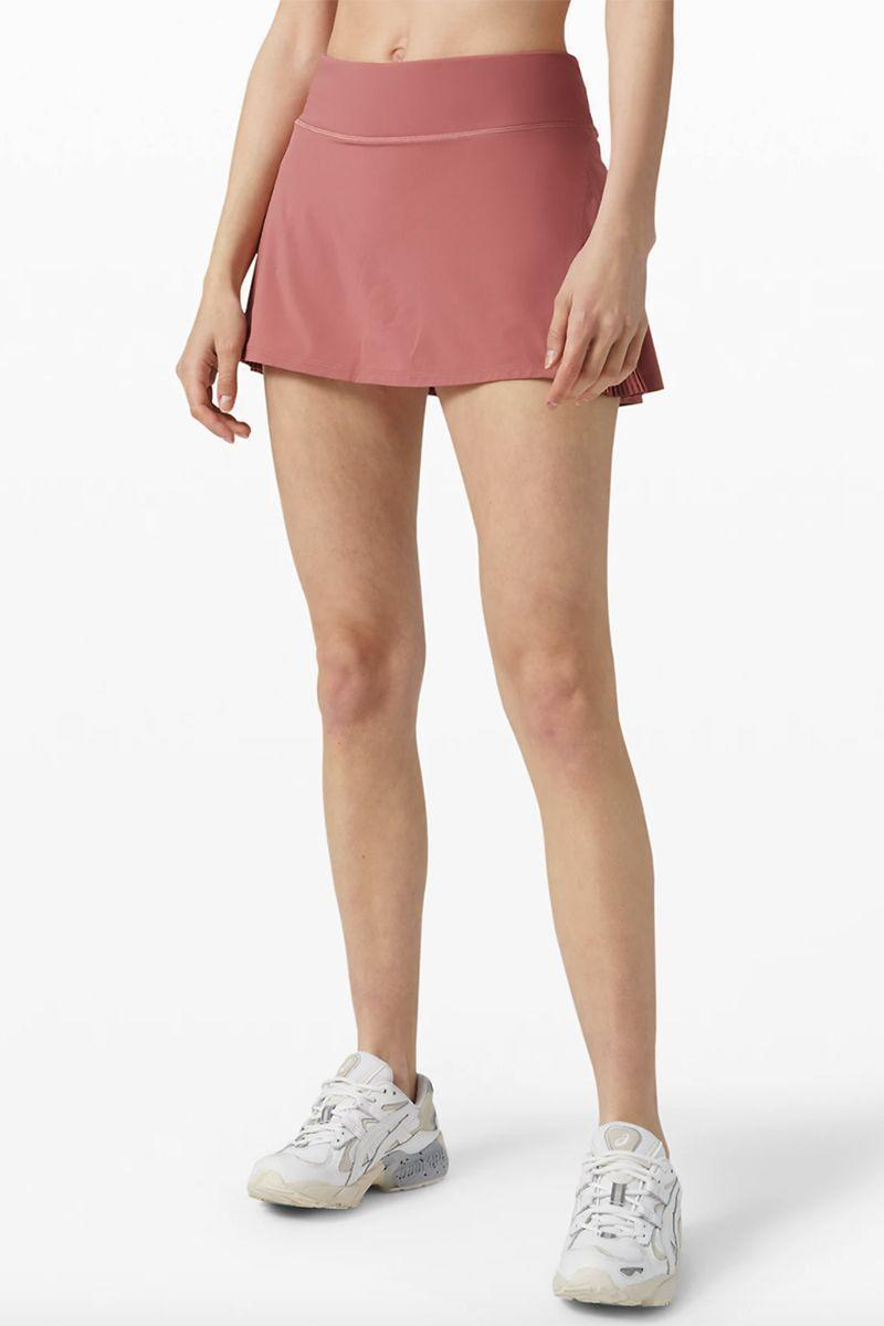 """<p><strong>Lululemon</strong></p><p>lululemon.com</p><p><strong>$68.00</strong></p><p><a href=""""https://go.redirectingat.com?id=74968X1596630&url=https%3A%2F%2Fshop.lululemon.com%2Fp%2Fskirts-and-dresses-skirts%2FPlay-Off-The-Pleats-Skirt%2F_%2Fprod8900670&sref=https%3A%2F%2Fwww.marieclaire.com%2Ffashion%2Fg33310213%2Fexercise-skorts%2F"""" rel=""""nofollow noopener"""" target=""""_blank"""" data-ylk=""""slk:SHOP IT"""" class=""""link rapid-noclick-resp"""">SHOP IT</a></p><p>This skirt is designed for tennis and comes in three different shades, though our favorite is this blush tone. Fans of the skort say it's flattering and comfortable, though the shorts run a bit tight so you might want to size up. </p>"""