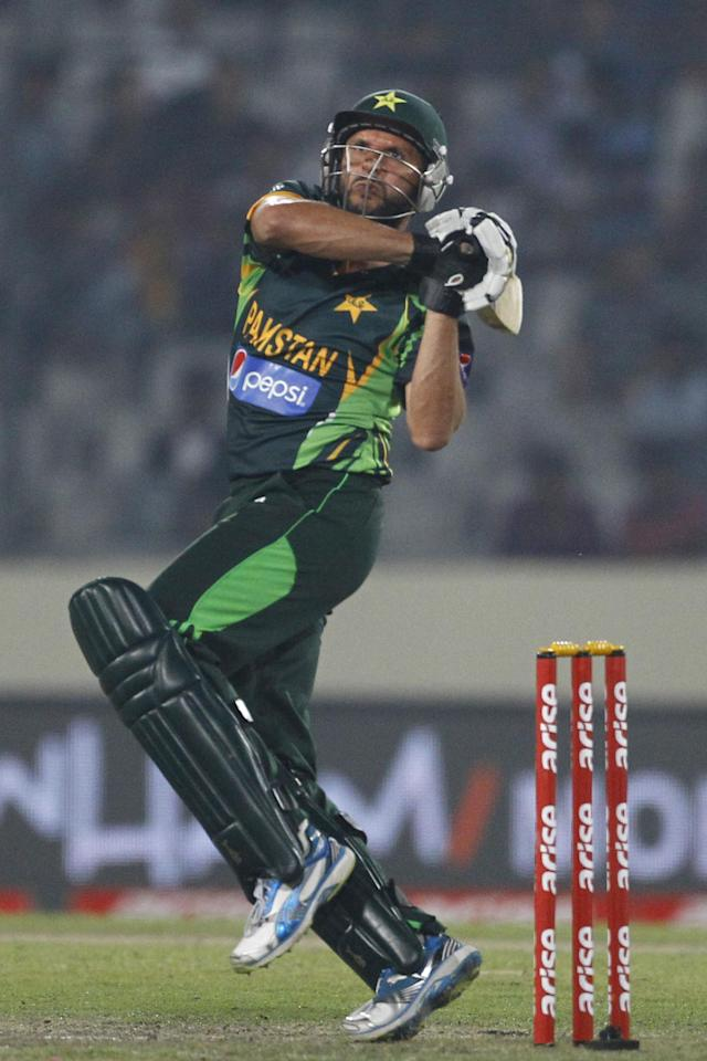 Pakistan's Shahid Afridi, plays a shot during their match against Bangladesh in the Asia Cup one-day international cricket tournament in Dhaka, Bangladesh, Tuesday, March 4, 2014. (AP Photo/A.M. Ahad)