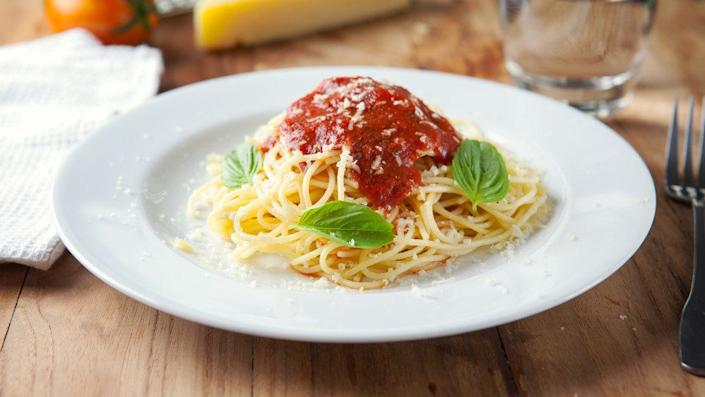 """Pasta topped with <a href=""""https://ndb.nal.usda.gov/ndb/foods/show/19434?manu=&fgcd=&ds="""" target=""""_blank"""">1/2 cup of jarred tomato sauce</a>: 8 grams. <br /><br />Pasta sauce is one of those sneaky sugar sources we often talk about. Not all brands are high in the sweet stuff though, so check the label before you put it in your shopping cart. Or better yet, make your own."""