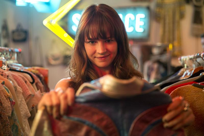 When we meet Girlboss's Sophia - a 23-year-old wild child barely, albeit tirelessly, scraping by in San Francisco in 2003 - she's pushing her stalled, rusted, junk bucket of a car up one of the city's infamously steep streets. Sophia, played by the charmingly caustic Britt Robertson, looks barely big enough to push a shopping cart of vintage clothes around a thrift store, let alone a vehicle.