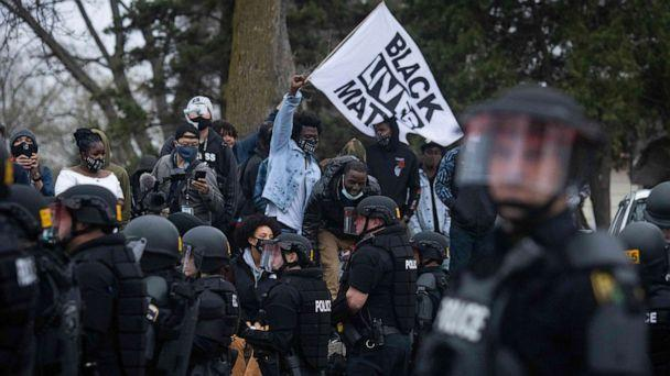 PHOTO: Protesters clash with police near the site where a family said a man was shot and killed by local law enforcement, Sunday, April 11, 2021, in Brooklyn Center, Minn. (AP Photo/Christian Monterrosa) (Christian Monterrosa/AP)