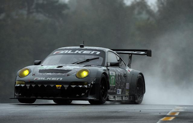 Wolf Henzler, of Germany, drives the Team Falken Tire Porsche 911 GT3 RSR during practice for the American Le Mans Series' Petit Le Mans auto race at Road Atlanta, Thursday, Oct. 17, 2013, in Braselton, Ga. (AP Photo/Rainier Ehrhardt)