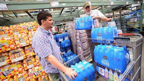 PHOTO: Residents Al-Muthanna Al-Ani (L) and Lloyd Strickland buy supplies in preparation for Hurricane Dorian at BJ's store, Aug. 29, 2019, in Orlando, Fla. (Gerardo Mora/Getty Images)
