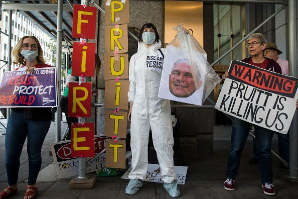 Protestors rally against Environmental Protection Agency (EPA) Administrator Scott Pruitt outside the federal office building that houses the New York City office of the EPA, June 6, 2018. Pruitt is under fire again this week after emails showed he asked an EPA staff member to contact Chick-fil-A for potential business opportunities for his wife. Federal ethics rules prohibit government employees from using their positions for private gain and prohibit supervisors from directing subordinates to carry out personal errands. Earlier in the week it was also disclosed that Pruitt asked an aide to inquire with the Trump International Hotel about purchasing a used mattress. (Photo by Drew Angerer/Getty Images)