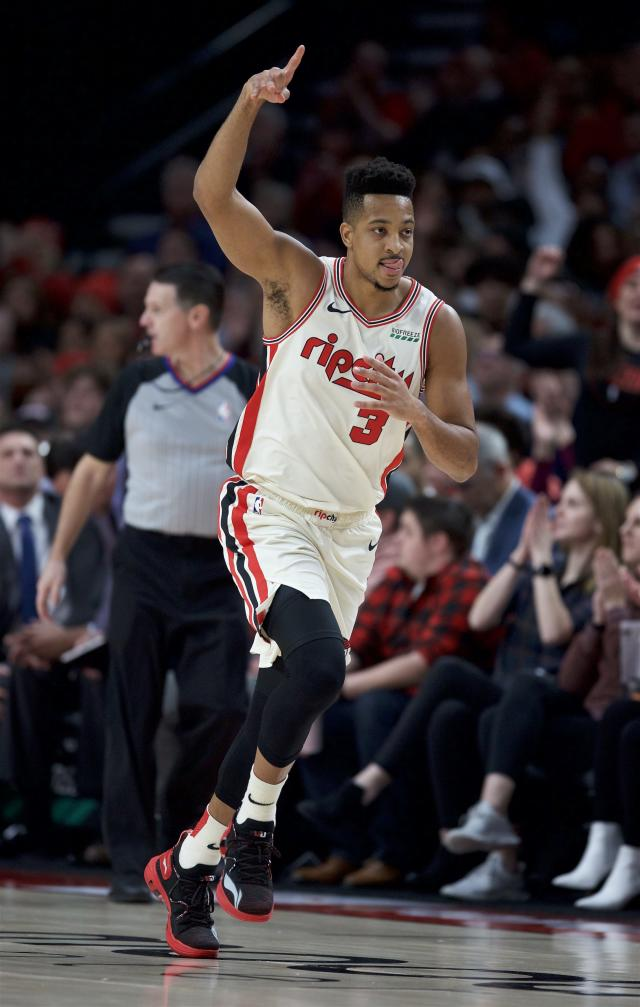 Portland Trail Blazers guard CJ McCollum reacts after making a three-point basket against the Los Angeles Lakers during the first half of an NBA basketball game in Portland, Ore., Saturday, Dec. 28, 2019. (AP Photo/Craig Mitchelldyer)