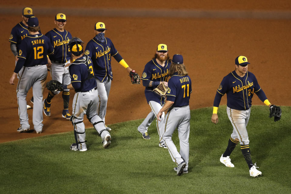 The Milwaukee Brewers celebrates after beating the Chicago Cubs 4-3 in a baseball game Friday, Aug. 14, 2020, in Chicago. (AP Photo/Jeff Haynes)