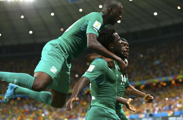 Ivory Coast's Bony celebrates with his teammates Gervinho and Toure after scoring a goal against Greece during their 2014 World Cup Group C soccer match at the Castelao arena in Fortaleza