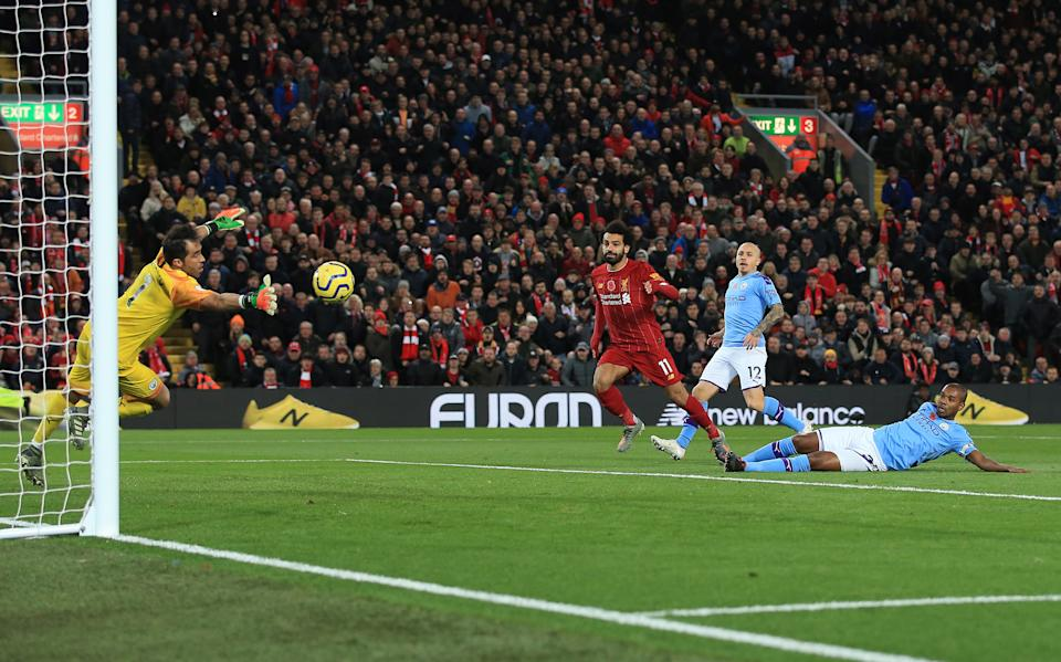 LIVERPOOL, ENGLAND - NOVEMBER 10: Mohamed Salah of Liverpool scores their 2nd goal during the Premier League match between Liverpool FC and Manchester City at Anfield on November 10, 2019 in Liverpool, United Kingdom. (Photo by Simon Stacpoole/Offside/Getty Images)