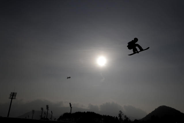 <p>Sebastien Toutant, of Canada, jumps during training for the men's Big Air snowboard competition at the 2018 Winter Olympics in Pyeongchang, South Korea, Saturday, Feb. 24, 2018. (AP Photo/Matthias Schrader) </p>