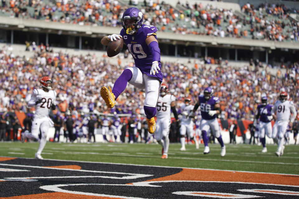 Minnesota Vikings wide receiver Adam Thielen (19) leaps into the end zone with the ball to score a touchdown in the third quarter of an NFL football game against the Cincinnati Bengals, Sunday, Sept. 12, 2021, in Cincinnati. (Andrew Souffle/Star Tribune via AP)