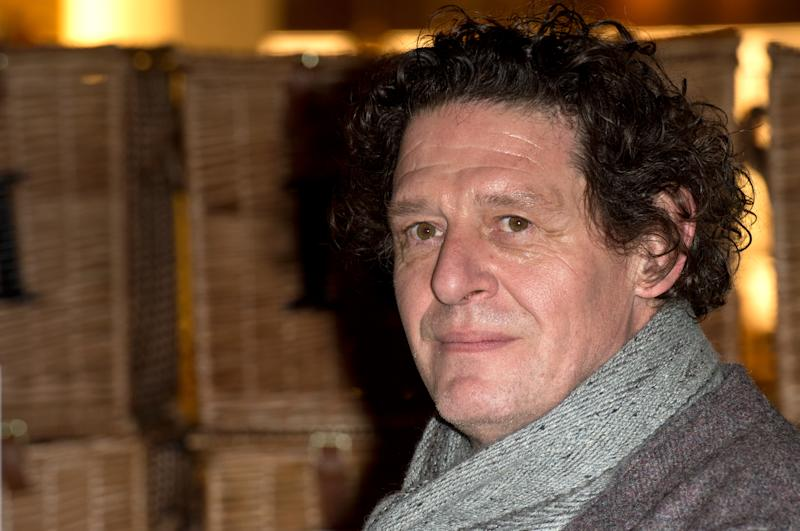 "Marco Pierre White signs copies of the 25th anniversary edition of his classic book, ""White Heat 25"" at Fortnum & Mason in London. (Photo by Zak Hussein/Corbis via Getty Images)"