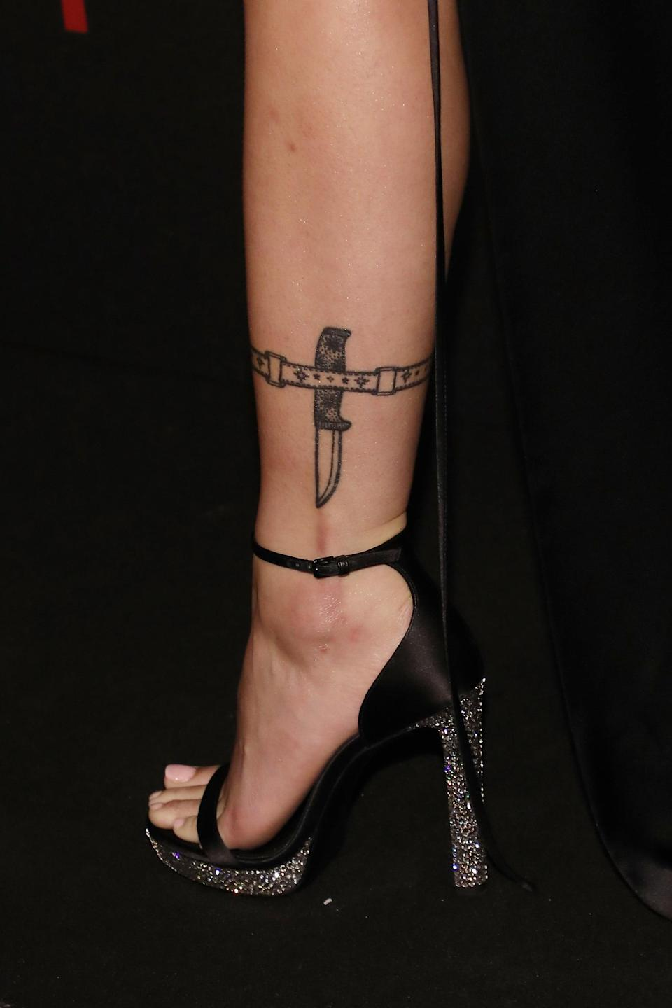 "<p>Halsey got this knife and belt tattoo on her leg in 2014 by tattoo artist <a href=""https://www.instagram.com/emilymalice/"" class=""link rapid-noclick-resp"" rel=""nofollow noopener"" target=""_blank"" data-ylk=""slk:Emily Malice"">Emily Malice</a> in September 2014.</p>"