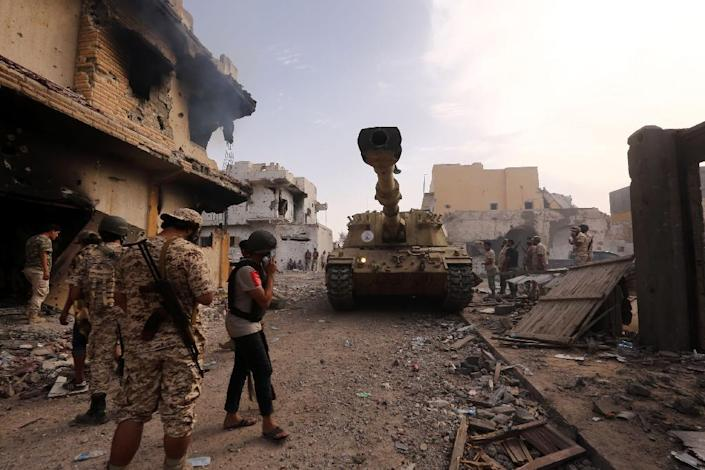 Forces loyal to Libya's UN-backed government gather in Sirte in October 2016, during their offensive to oust Islamic State group jihadists from the city (AFP Photo/MAHMUD TURKIA)