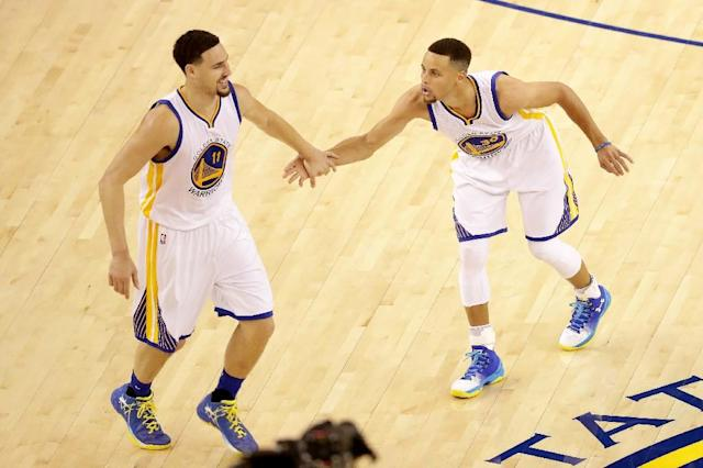 Klay Thompson (L) and Stephen Curry (R) outshined Russell Westbrook as the Golden State Warriors romped to a 111-95 victory against the Oklahoma City Thunder, at Chesapeake Energy Arena in Oklahoma City, on March 20, 2017 (AFP Photo/Ezra Shaw)