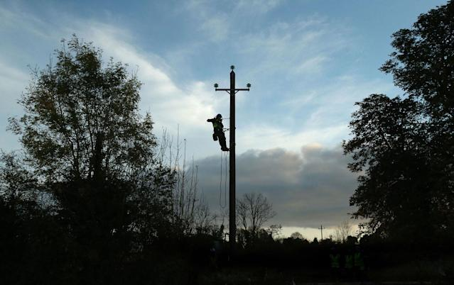 <p>Workers in Kilcock, Ireland, clear fallen power lines after Hurricane Ophelia batterred the UK and Ireland with gusts of up to 80mph on Oct. 17, 2017. (Photo: Niall Carson/PA Images via Getty Images) </p>