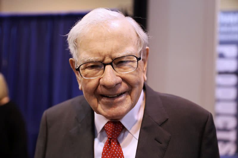FILE PHOTO: Berkshire Hathaway Chairman Warren Buffett walks through the exhibit hall as shareholders gather to hear from the billionaire investor at Berkshire Hathaway Inc's annual shareholder meeting in Omaha