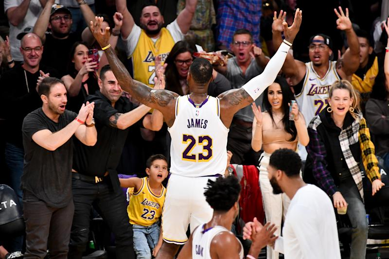 Lakers fans celebrate with LeBron James during a recent win. (Allen Berezovsky/Getty Images)