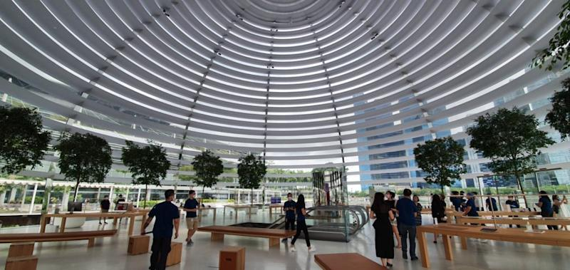 Guides showing visitors around the Apple store. Photo: Coconuts Singapore