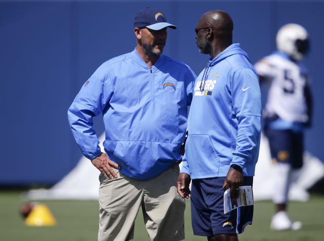 Los Angeles Chargers defensive coordinator Gus Bradley, left, talks with coach Anthony Lynn during practice at the NFL football team's minicamp Wednesday,June 13, 2018, in Costa Mesa, Calif. (AP Photo/Chris Carlson)