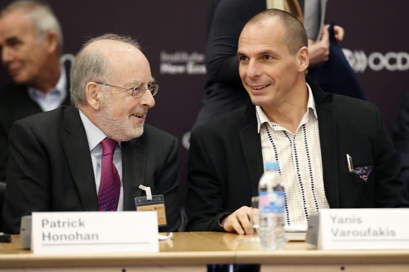 Governor of the Central Bank of Ireland Patrick Honohan and Greek Finance Minister Yanis Varoufakis attend the annual conference of the Institute for New Economic Thinking at the OECD headquarters in Paris