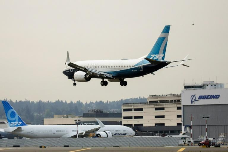 A Boeing 737 MAX airliner piloted by Federal Aviation Administration (FAA) Administrator Steve Dickson lands following an evaluation flight in Seattle, Washington