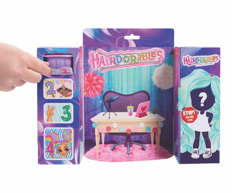 """These collectible dolls have a """"big hair, don't care"""" attitude and come in this scene-setting box. Unlock the surprises on the left to get her accessories, then reveal which doll you have on the right.<br />Price: &pound;15<br />Ages: 3+<br /><a href=""""http://hamleys.com/shopkins-hairdorables-doll-assortment.ir"""" target=""""_blank"""" rel=""""noopener noreferrer"""">Click here to buy.</a>"""