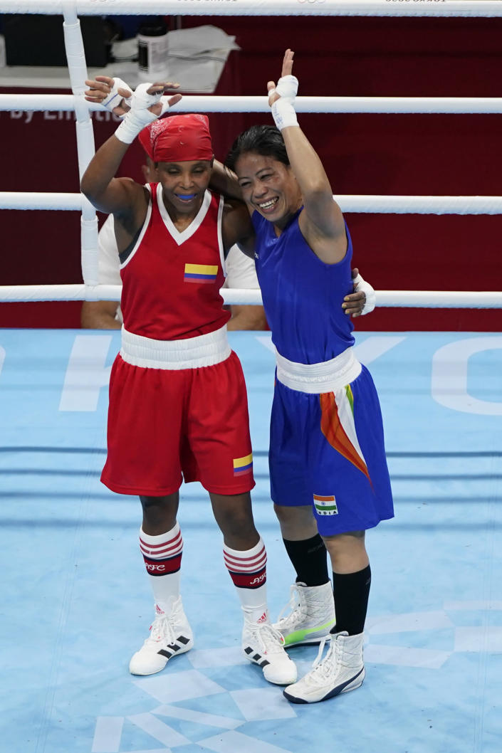 Columbia's Ingrit Lorena Valencia Victoria, left, and India's Chungneijang Mery Kom Hmangte after their women's flyweight 51-kg boxing match at the 2020 Summer Olympics, Thursday, July 29, 2021, in Tokyo, Japan. (AP Photo/Frank Franklin II)