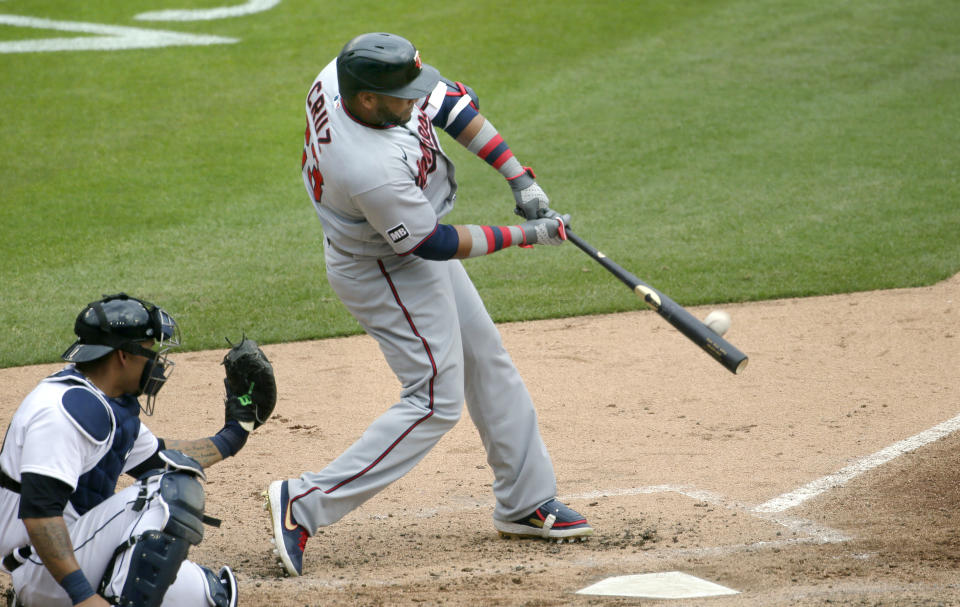DETROIT, MI -  APRIL 5:  Nelson Cruz #23 of the Minnesota Twins hits a solo home run with catcher Wilson Ramos #40 of the Detroit Tigers behind the plate during the fifth inning at Comerica Park on April 5, 2021, in Detroit, Michigan. (Photo by Duane Burleson/Getty Images)