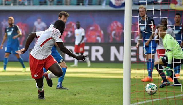 Soccer Football - Bundesliga - RB Leipzig vs TSG 1899 Hoffenheim - Red Bull Arena, Leipzig, Germany - April 21, 2018 RB Leipzig's Dayot Upamecano scores their second goal REUTERS/Matthias Rietschel DFL RULES TO LIMIT THE ONLINE USAGE DURING MATCH TIME TO 15 PICTURES PER GAME. IMAGE SEQUENCES TO SIMULATE VIDEO IS NOT ALLOWED AT ANY TIME. FOR FURTHER QUERIES PLEASE CONTACT DFL DIRECTLY AT + 49 69 650050