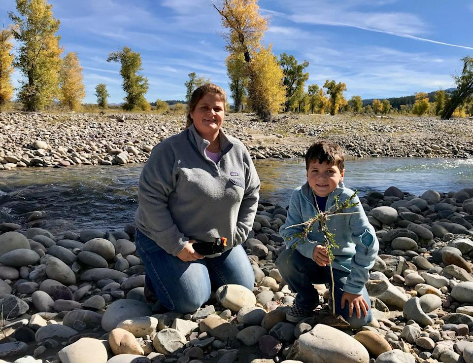 Marianne and Caleb Kay with their home made cross close to where Gabby Petito's body was found (Andrew Buncombe)