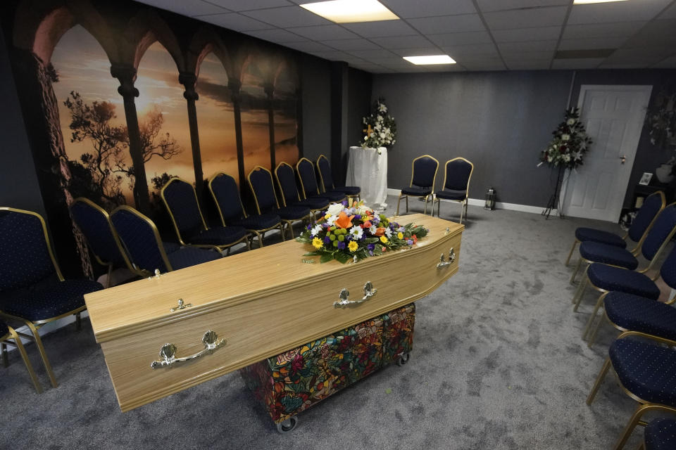 SHIPLEY, WEST YORKSHIRE - MAY 26: The casket of Covid-19 victim Dennis Clapham, aged 62, is prepared to be transported to Nab Wood Crematorium on May 26, 2020 in Shipley, West Yorkshire. His sister Ann Clapham cared for him whilst he suffered from ill health at home. He later moved into a care home where he could get the extra help he needed. Dennis and Ann had planned his funeral arrangements two years ago. Guardian Funerals is a family-owned funeral service in Shipley, West Yorkshire, that, like many such providers, has confronted the unique challenges presented by Covid-19. There are new rules for how the deceased are handled and how family members can commemorate the deceased prior to burial or cremation -- restrictions that can make a tough situation even tougher. The home's director, Alison Barrington, is a third-generation undertaker who believes that the pastoral element of being a funeral director is as important to bereaved families as the professional undertaker services that they provide. Alison, who works alongside her husband Daniel and a small team, believes that people are failing to associate the graphs and figures describing the Covid-19 death toll with the human victims of the crisis and the devastating effect it has had on families across the world. (Photo by Christopher Furlong/Getty Images)