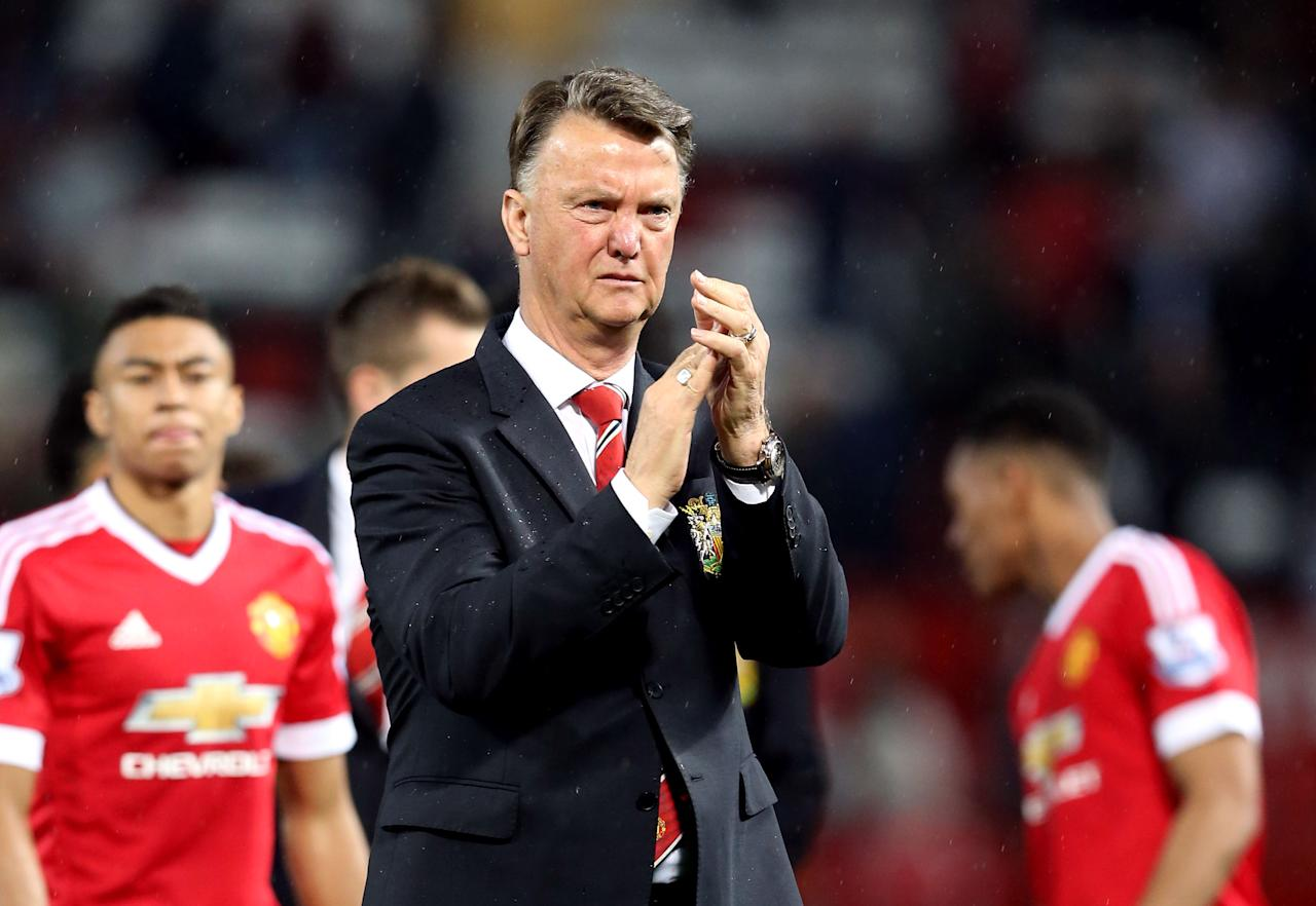 Manchester United manager Louis van Gaal applauds after the English Premier League soccer match against Bournemouth at Old Trafford, Manchester, England, Tuesday May 17, 2016. (Martin Rickett/PA via AP) UNITED KINGDOM OUT
