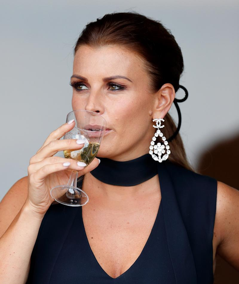 Coleen Rooney watches the racing as she attends day three 'Grand National Day' of The Randox Health Grand National Festival at Aintree Racecourse on April 14, 2018 in Liverpool, England. (Photo by Max Mumby/Indigo/Getty Images)