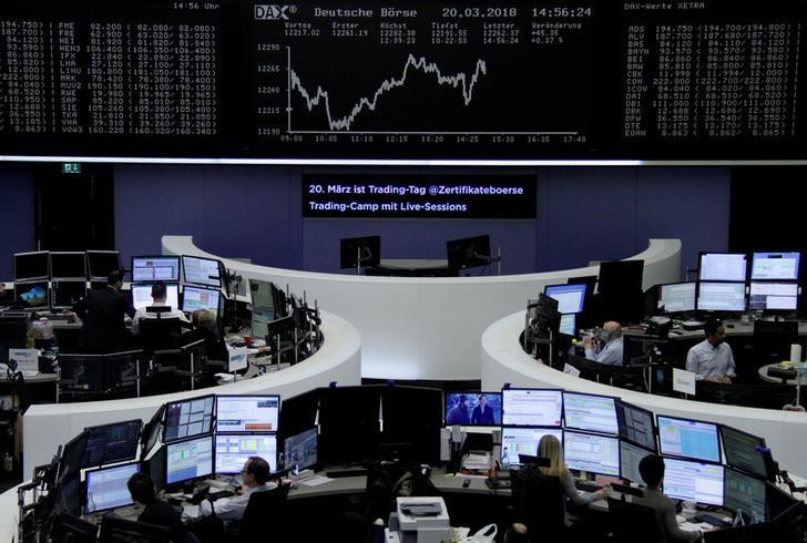FILE PHOTO: The German share price index, DAX board, is seen at the stock exchange in Frankfurt, Germany, March 20, 2018. REUTERS/Staff/File Photo