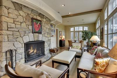 """The main residence offers ample space for rest and relaxation or for entertaining. The cozy """"sunroom"""" (pictured here) is one such venue for quality R&R. LakefrontLuxuryAuction.com."""