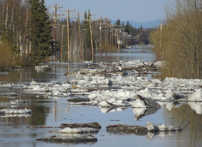 In this May 27, 2013 photo released by the National Weather Service, ice and water cover the roads in Galena, Alaska. Several hundred people are estimated to have fled the community of Galena in Alaska's interior, where a river ice jam has caused major flooding, sending water washing over roads and submerging buildings. (AP Photo/National Weather Service, Ed Plumb)