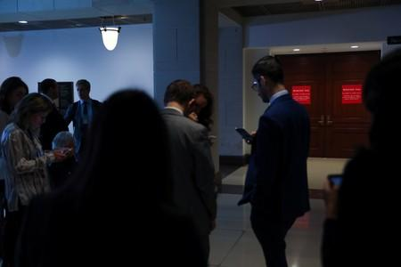 Reporters wait outside of closed U.S. House Intelligence Committee rooms while Intelligence Community Inspector General Atkinson attends a closed briefing on the handling of a reported whistleblower complaint against the Trump White House, on Capitol Hill