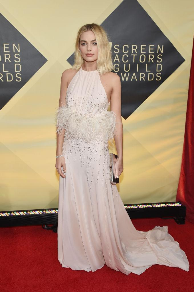 <p>The <em>I, Tonya</em> star had both pearls and feathers featured on her light-pink haltered dress. (Photo: Getty Images) </p>
